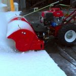 Turf Teq Power Broom Removing Snow